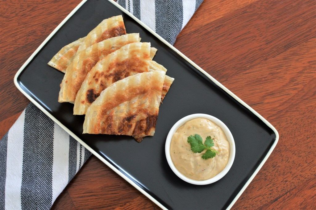 Roti tapa with a satay sauce